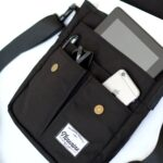 VIBRANT BLACK SLING front pockets